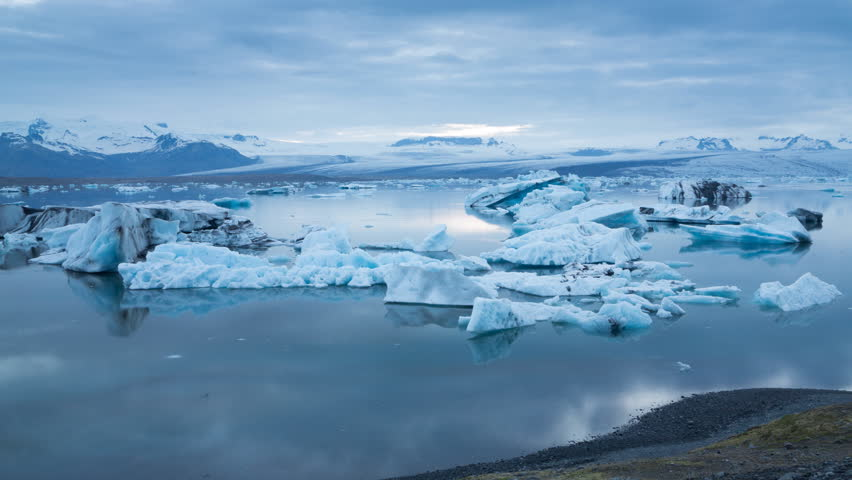 Midnight sun Time lapse of blue icebergs floating in Jokulsarlon glacial lagoon, Iceland (4K version available)