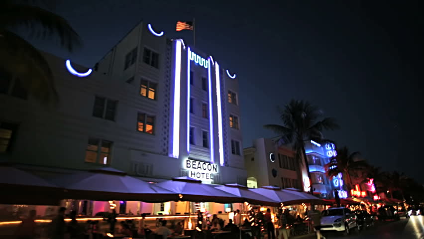 Night P.O.V. driving by illuminated restaurants on Ocean Drive Miami Art deco district of South Beach Florida, USA