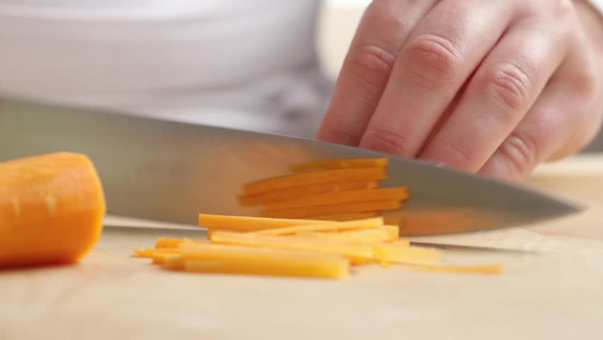 Chopping carrots into julienne strips - HD stock video clip