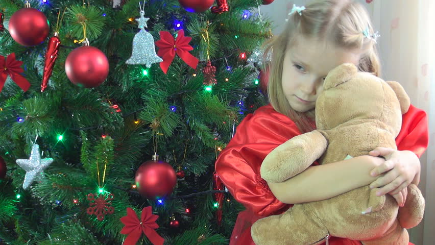 Child Playing with Teddy Bear Toy as Present, Girl by a Christmas Tree, Children - HD stock footage clip
