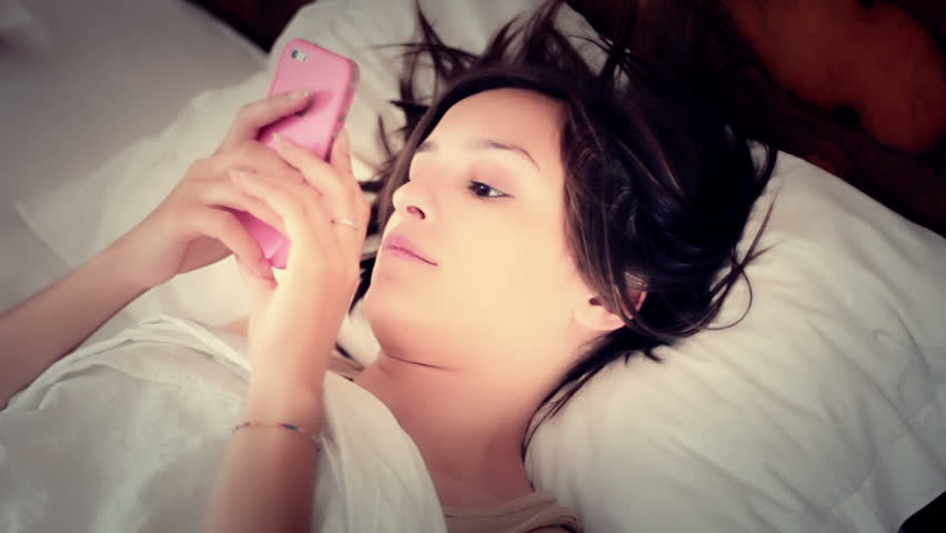 Pretty young woman using mobile phone - Smartphone - HD stock video clip
