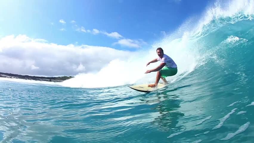 Surfer Riding Blue Ocean Wave Watershot