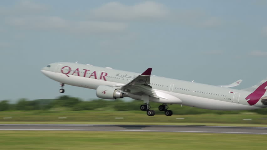 MANCHESTER, LANCASHIRE/ENGLAND - JULY 05: Qatar Airbus A330 takes off from Manchester Airport on July 05, 2013 in Manchester. Qatar Airways will attain membership of Oneworld Alliance in October 2013.