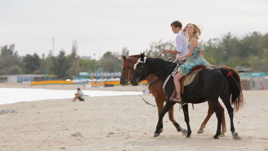 Couple Is Riding Horses On The Beach Hd Stock Footage Clip