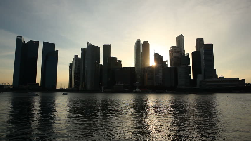 Singapore's silhouetted skyline at sunset. - HD stock video clip