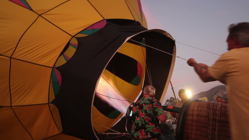 SANTA PAULA, CA - JUL 26: A balloon crew inflates the envelope of their hot air balloon at the Citrus Classic Hot Air Balloon Festival on July 26, 2013 in Santa Paula, CA.