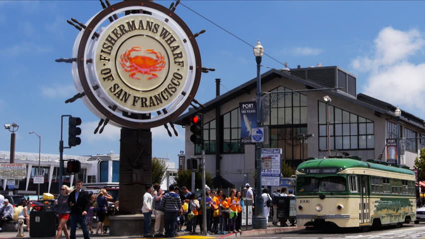 SAN FRANCISCO-JULY 9 2013: a cable car travels past the famous fisherman's wharf district of san francisco
