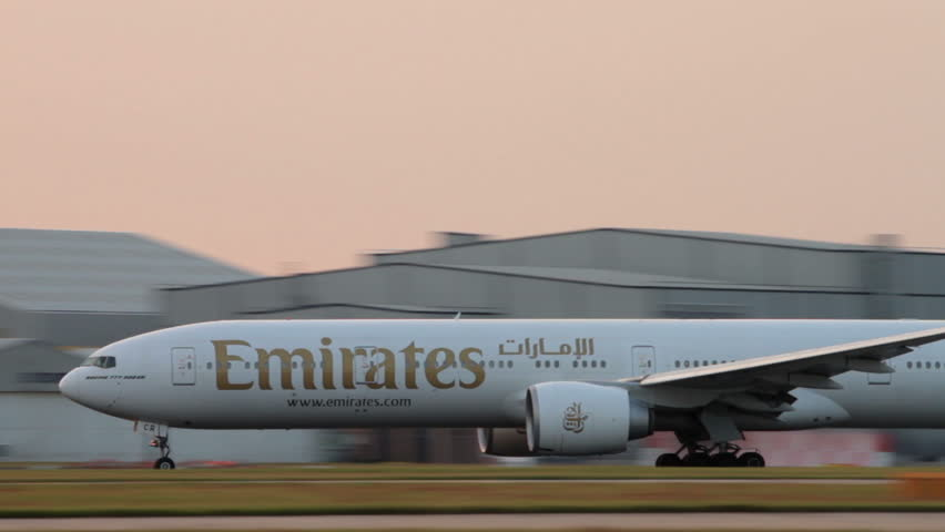 MANCHESTER, LANCASHIRE/ENGLAND - JULY 17: Emirates Boeing 777 plane takes off at sunset on July 17, 2013 in Manchester. Emirates was founded in 1985 and voted Airline of the Year in 2013.