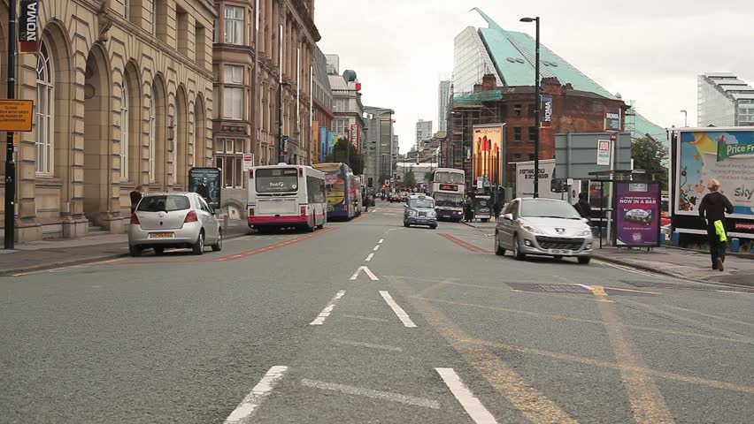 A busy road leading into Manchester city centre
