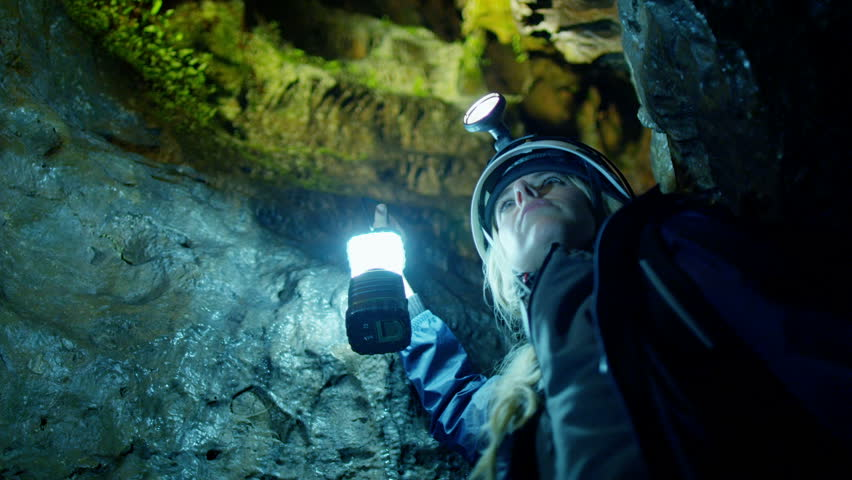 Scientists and miners exploring dark caves. Geologists, explorers, adventurers, pot holing, historians or mining company. - HD stock video clip