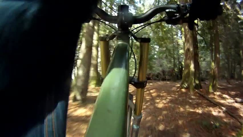 Low Angle First Person View of Bicycle Riding on Trail - HD stock footage clip