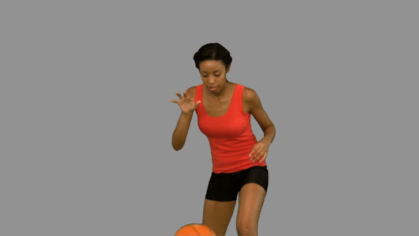 A Woman Playing Basketball Imágenes De Stock A Woman: Woman Catching And Throwing A Basketball On Grey Screen In