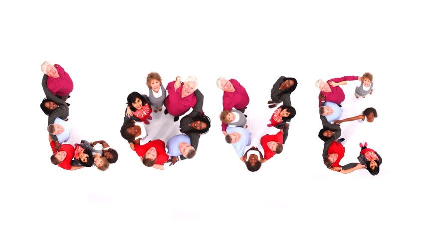 "Group of various people coming together to spell the word ""Love"". Shot in large white studio. High quality HD video footage."