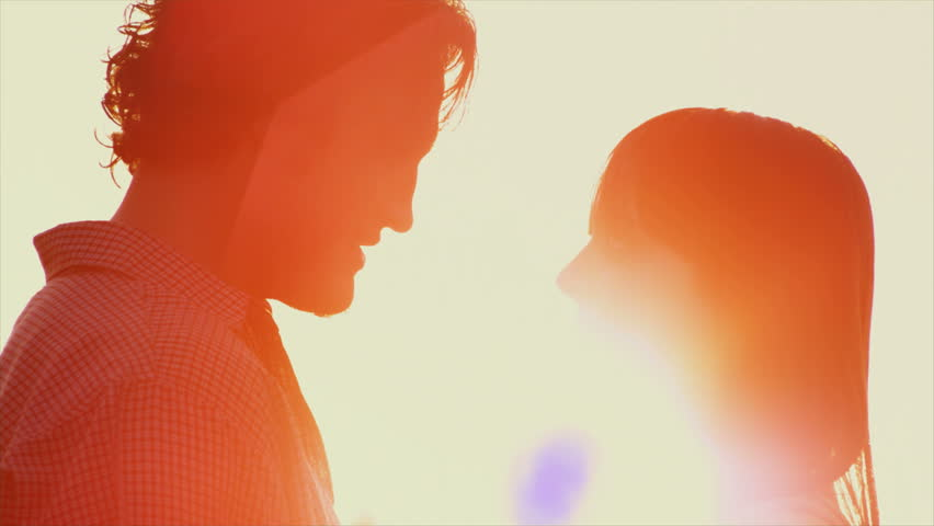 Beautiful Young Couple in Love kiss in the sun