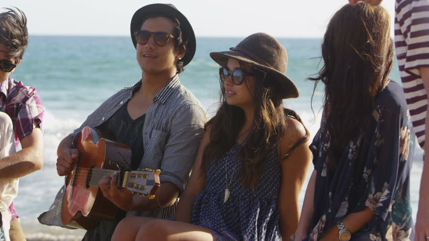 Group of young people hanging out at beach - HD stock footage clip