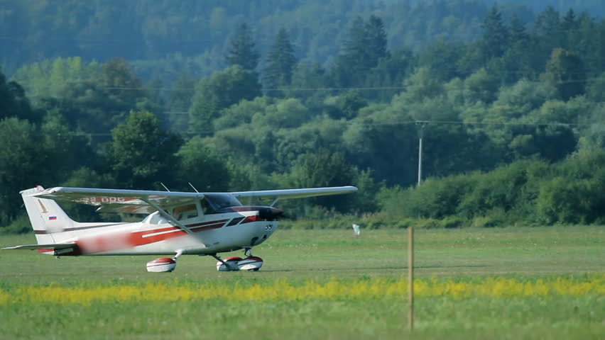 Close up of small airplane taking off - HD stock footage clip