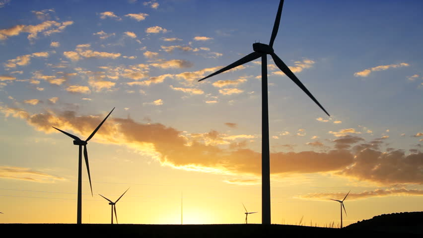 A wind farm of wind turbines creating green energy in Andalucia, Spain, Europe - HD stock video clip