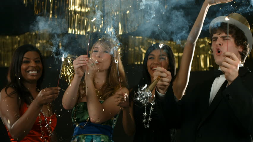 Group of people at New Year's party with sparklers - HD stock footage clip