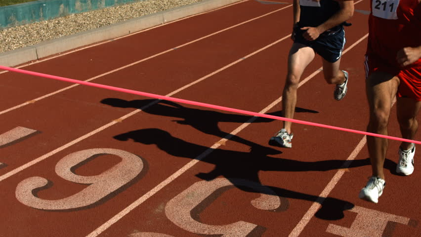Track runners at finish line, slow motion