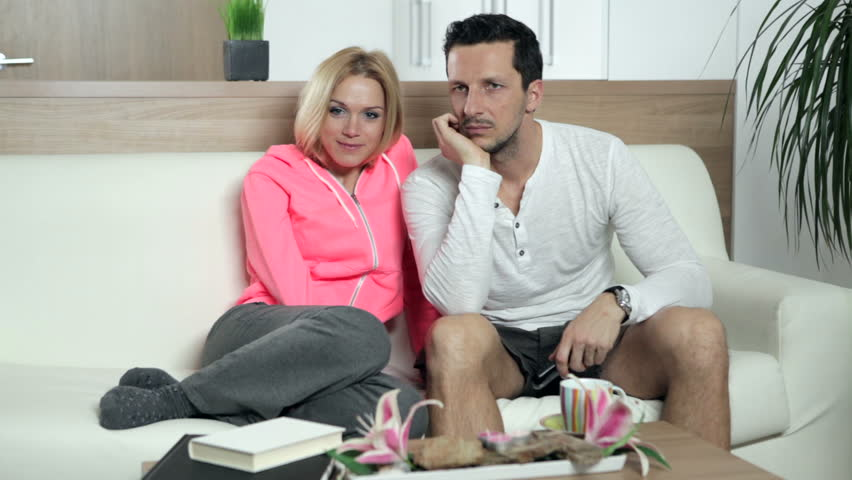 couple watching tv very seriously high definition video stock footage video 4818263 shutterstock. Black Bedroom Furniture Sets. Home Design Ideas