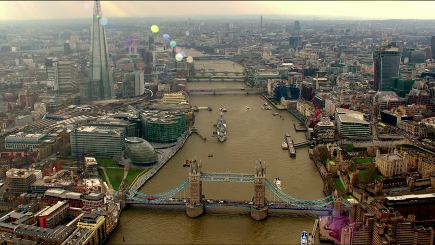 Aerial sequence of the River Thames in Central London, UK. Shot features Tower Bridge, The Shard building and the Millennium Wheel (London Eye)