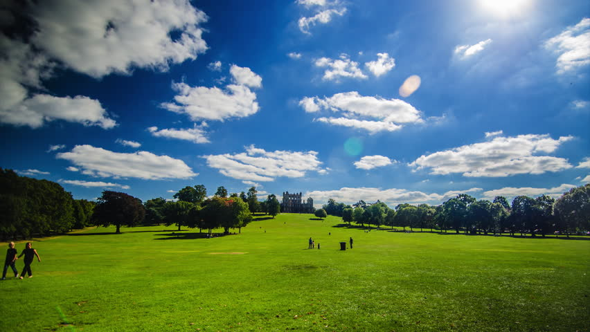 NOTTINGHAM - SEPT 22: Wollaton Hall in Nottingham, UK a sunny sunday 22nd of September, family picnics and walks in the Wollaton Park.  - HD stock footage clip