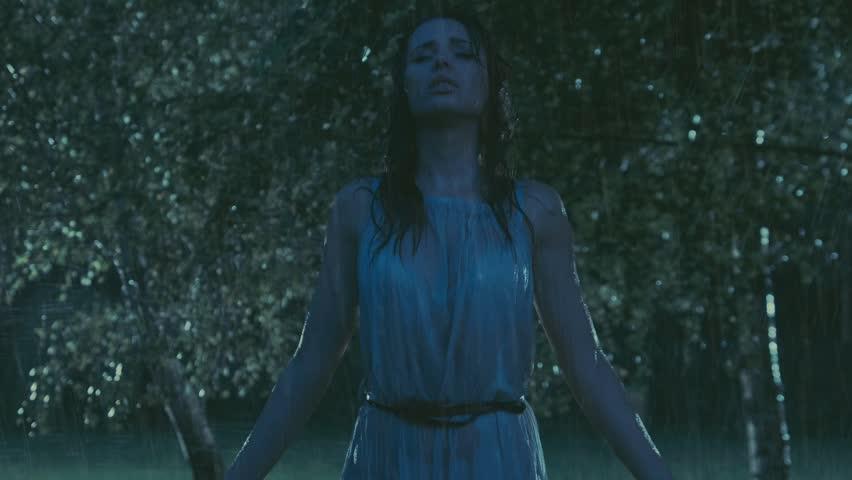Sad woman in the rain - HD stock footage clip