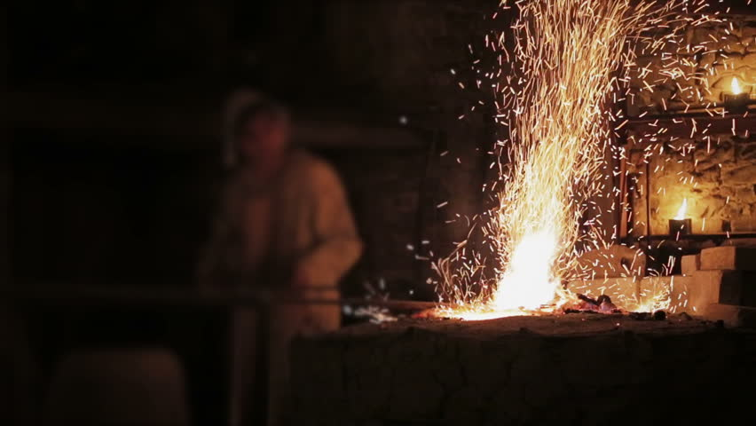 Blacksmith working with Fire an Metal