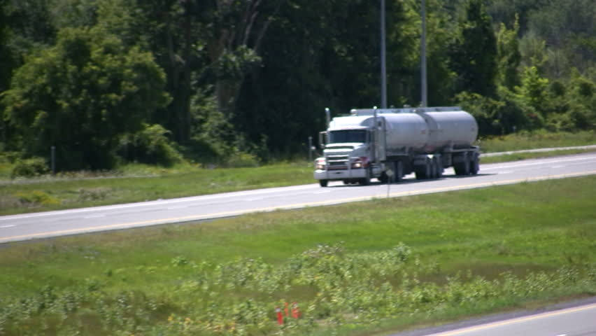 Gasoline Tanker Truck Driving On A Highway