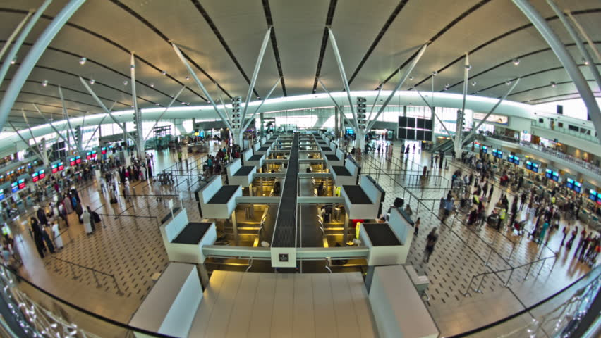 Airport travelers time lapse clip using a fisheye lens. Slight circular blur.