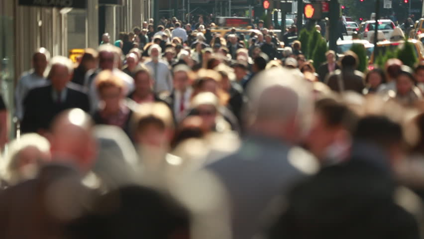 Anonymous crowd of people walking on New York City street slow motion