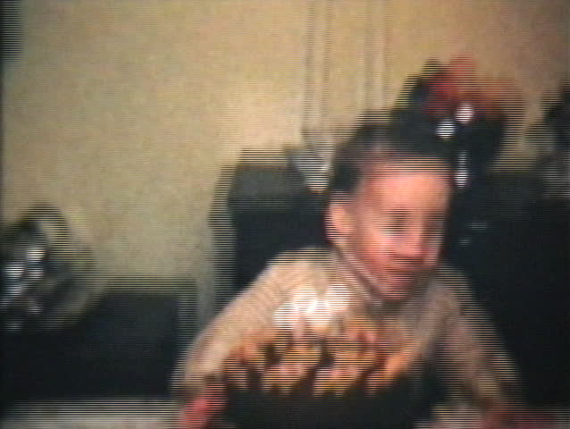 A Little Boy Blows Out Candles On His Birthday Cake in 1964. (Vintage 8mm film footage)