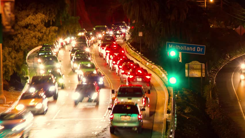 Pan across Hollywood 101 freeway / Mulholland Drive traffic at night. Timelapse. - HD stock footage clip