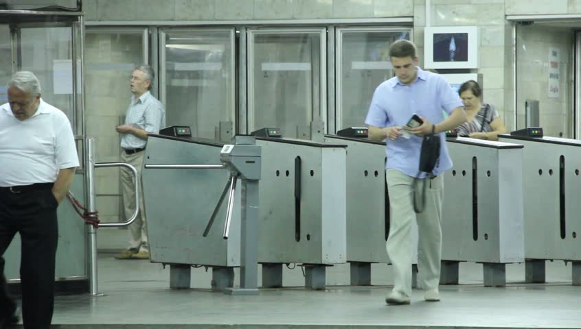 UKRAINE, KIEV, MAY 20, 2010: People inside underground station. Turnstile, Kiev, Ukraine, May 20, 2010 - HD stock video clip