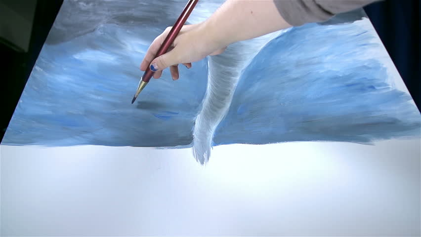 Wide angle of tornado artwork artist fixing blue background - HD stock footage clip
