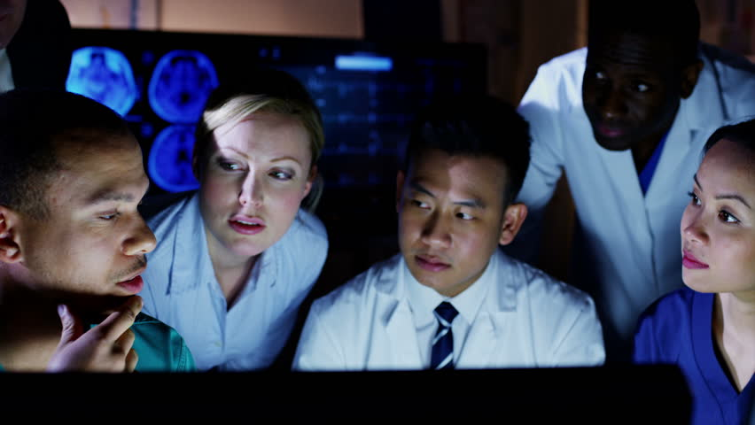 Mixed Ethnicity Group Of Medical Professionals Working ...