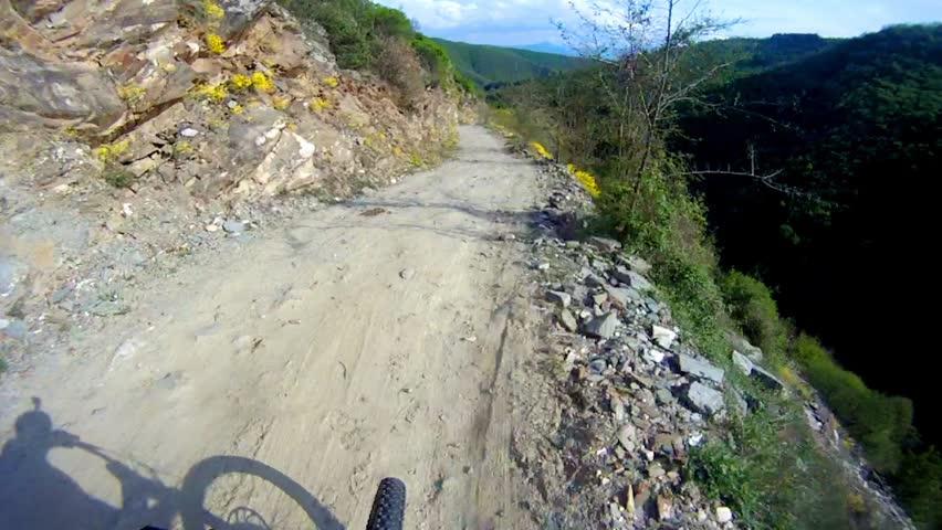 Mountain biker fast downhill sport race ride Stock Video