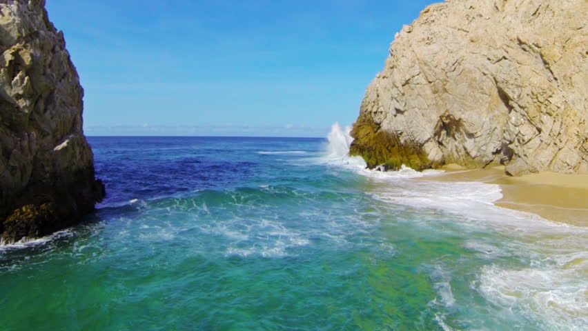 Ocean waves crashing on dramatic seaside cliffs - HD stock video clip