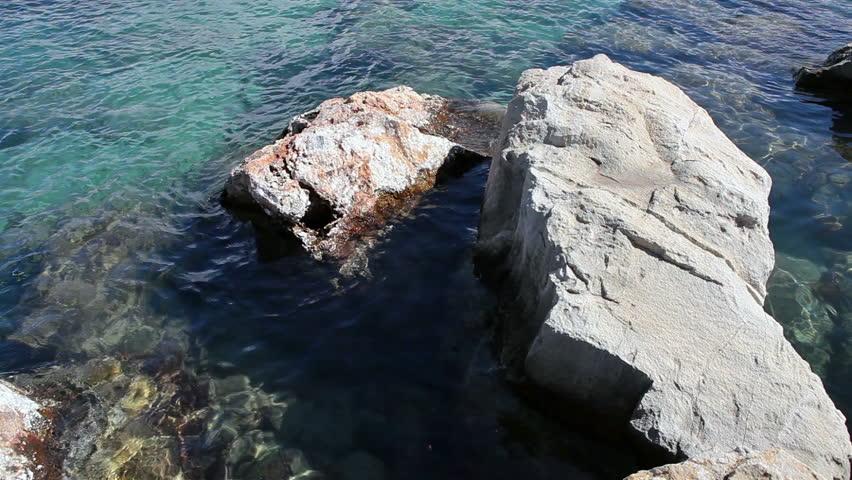 Sea waves splashing on the reefs in the Mediterranean sea, in Paphos, Cyprus - HD stock footage clip