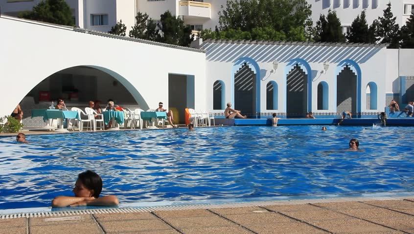 TUNISIA, SOUSSE, JULY 3, 2010: People in blue swimming pool in hotel, Sousse, Tunisia, July 3, 2010 - HD stock footage clip