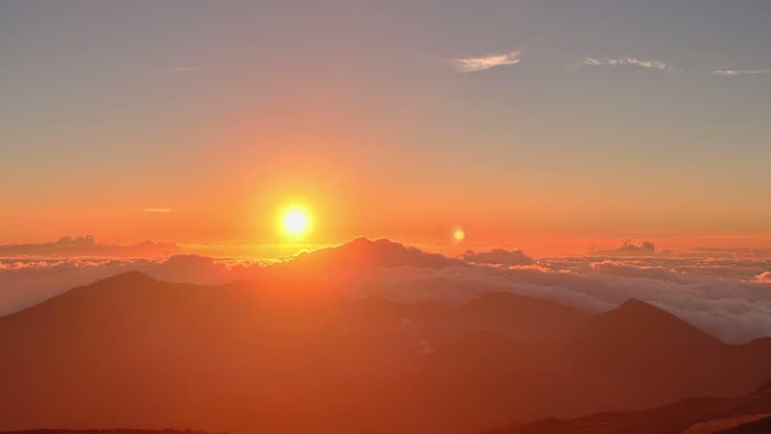Rising Sun, Moon, Stars, over high mountain range summit