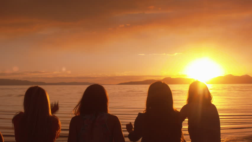 Group Of Girls Spell Love With Their Fingers At Sunset On ...