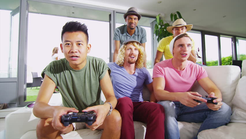A Young Adult Plays An Old Video Game A Young Man Plays