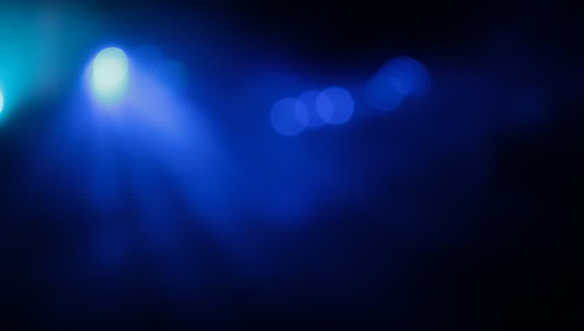 Stage Lights. Blue. Bright stage lights flashing.