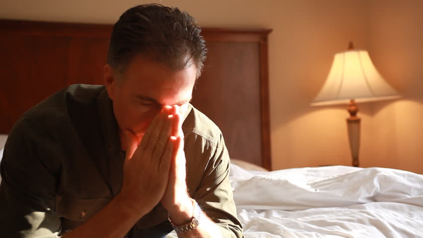 A man in a hotel room who appears to be troubled or anxious about something. - HD stock footage clip