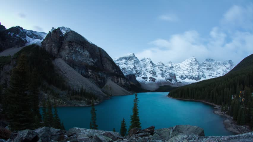 Time lapse Mornaie Lake rockpile cloudy morning in Banff National Park, Alberta, BC.