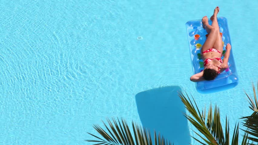 Boy Floats Inflatable Mattress In Pool And Then Turns
