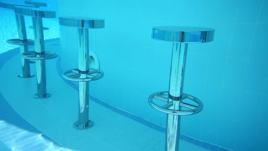 Round Metal Bar Chairs Underwater In Pure Blue Pool And