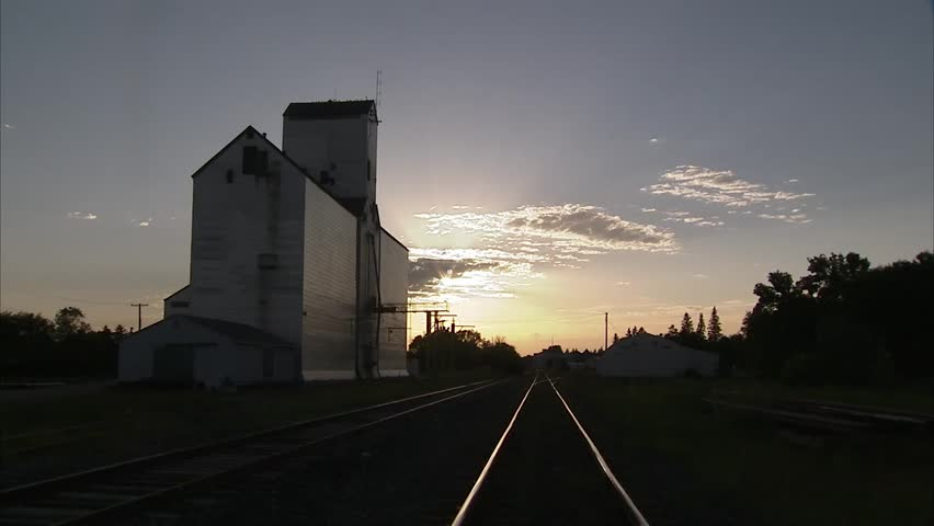 Grain elevator in the Manitoba countryside. - HD stock video clip