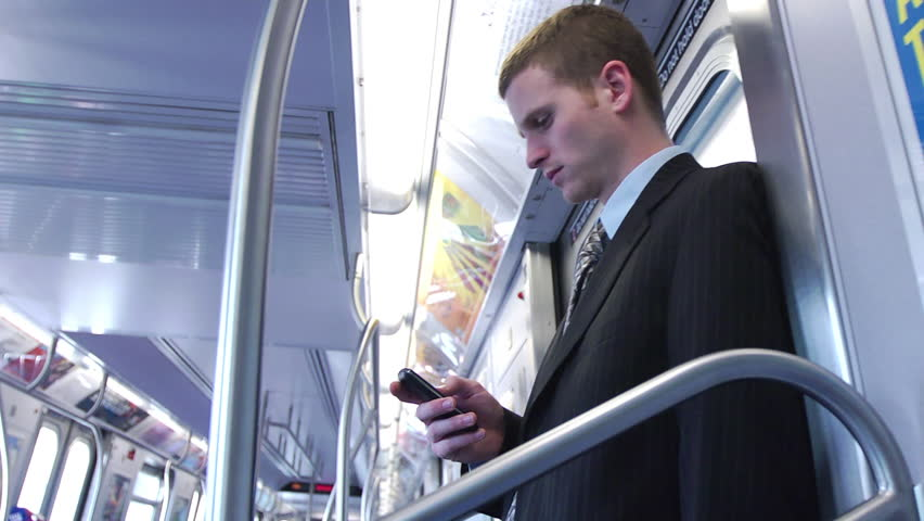 Business Man Using Smartphone on Clean Subway - Close Profile Shot